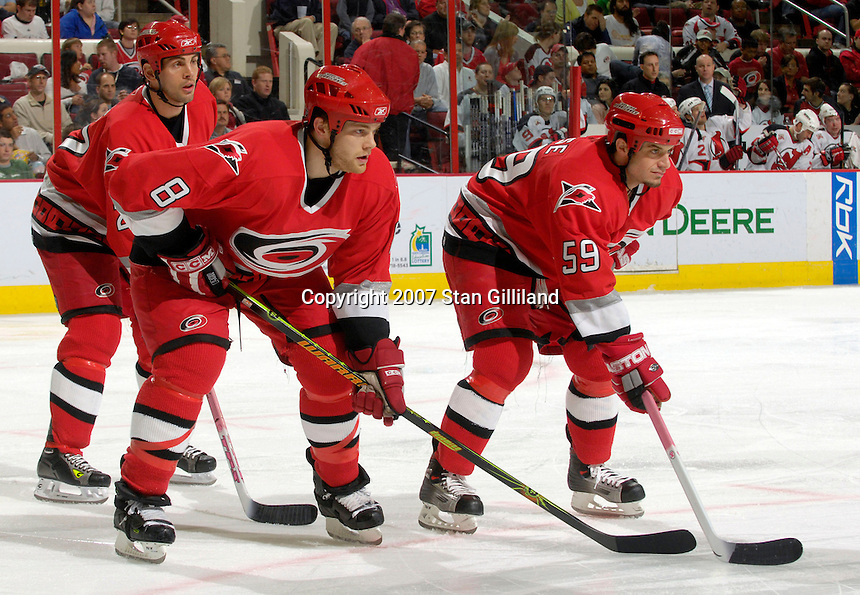 Carolina Hurricanes' Craig Adams, left, Tim Gleason (8) and Chad LaRose (59) ready for a faceoff with the New Jersey Devils Thursday, March 15, 2007 at the RBC Center in Raleigh, NC. New Jersey won 3-2.