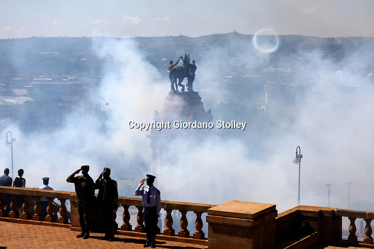 PRETORIA - 2 December 2010 - A member of the South African Army, the Presidential Guard and the South African Police Service saulte as a 21-gun salute is fired from the UNion buildings marking the arrival of Zambian President Rupiah Banda on a two-day state visit. -- APP/Allied Picture Press