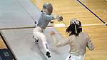 12 February 2017: Duke's Haley Fisher (left) attacks Boston College's Jackie Bai (right) during their Saber match. The Duke University Blue Devils hosted the Boston College Eagles at Card Gym in Durham, North Carolina in a 2017 College Women's Fencing match. Duke won the dual match 19-8 overall, 6-3 Foil, 5-4 Epee, and 8-1 Saber.