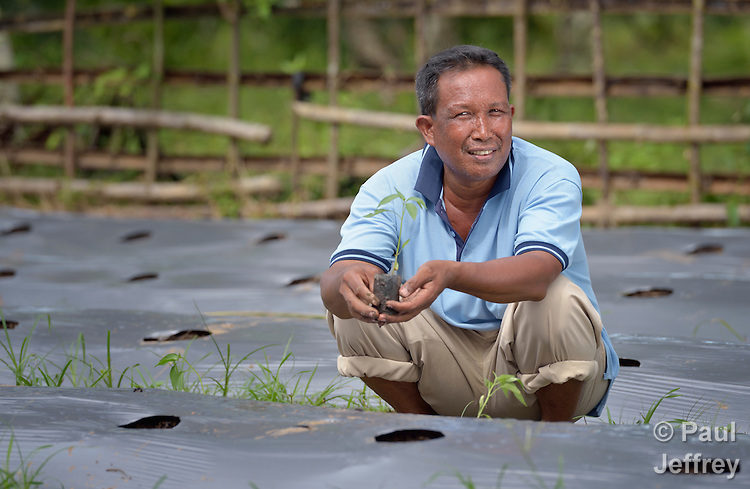 Muhammadin plants a new crop of chilies on his farm in Kubang Gajah in Indonesia's Aceh province. The tsunami-ravaged community got help from Church World Service, a member of the ACT Alliance, when it helped residents start a credit and loan cooperative. That allowed villagers to get their local economy moving quickly again, even as decisions about housing location lingered.
