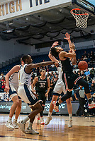 WASHINGTON, DC - JANUARY 29: Carter Collins #24 of Davidson drops the ball under the basket during a game between Davidson and George Wshington at Charles E Smith Center on January 29, 2020 in Washington, DC.
