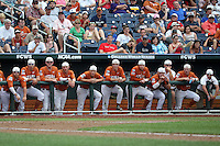 The Texas Longhorns wars rally caps during Game 1 of the 2014 Men's College World Series between the UC Irvine Anteaters and Texas Longhorns at TD Ameritrade Park on June 14, 2014 in Omaha, Nebraska. (Brace Hemmelgarn/Four Seam Images)