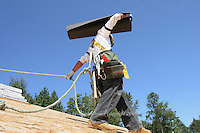 Pedro Vargas works on the roof of a new Quadrant Home in Mt. Vernon, Washington on August 4, 2006.