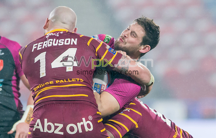 Picture by Allan McKenzie/SWpix.com - 15/03/2018 - Rugby League - Betfred Super League - Huddersfield Giants v Hull KR - John Smith's Stadium, Huddersfield, England - Ben Kavanagh is tackled by Dale Ferguson.