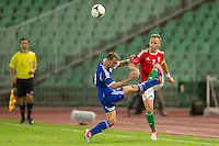 Israel's Elad Gabay (L) and Hungary's Balazs Dzsudzsak (R) fight for the ball during a friendly football match Hungary playing against Israel in Budapest, Hungary on August 15, 2012. ATTILA VOLGYI