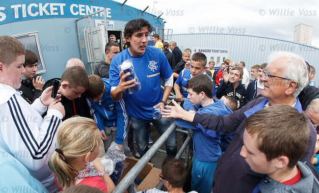 Fran Sandaza at the Rangers Ticket centre as Ibrox season tickets go on public sale and handing out Rangers gifts to the crowd.