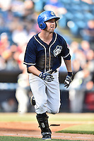 Asheville Tourists third baseman Chris Keck (16) rounds the bases after hitting a home run a during game against the Columbia Fireflies at McCormick Field on June 18, 2016 in Asheville, North Carolina. The Tourists defeated the Fireflies 5-4. (Tony Farlow/Four Seam Images)