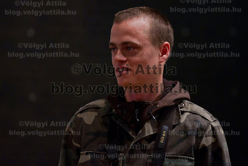 Nature photographer Bence Mate from Hungary presents the documentary movie showing his work during a press conference in Budapest, Hungary on December 12, 2011. ATTILA VOLGYI