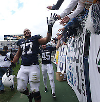 State College, PA - 11/02/2013:  Garry Gilliam (77) celebrates with student fans after the game.  Penn State defeated Illinois by a score of 24-17 in overtime on Saturday, November 2, 2013, at Beaver Stadium.<br /> <br /> Photos by Joe Rokita / JoeRokita.com