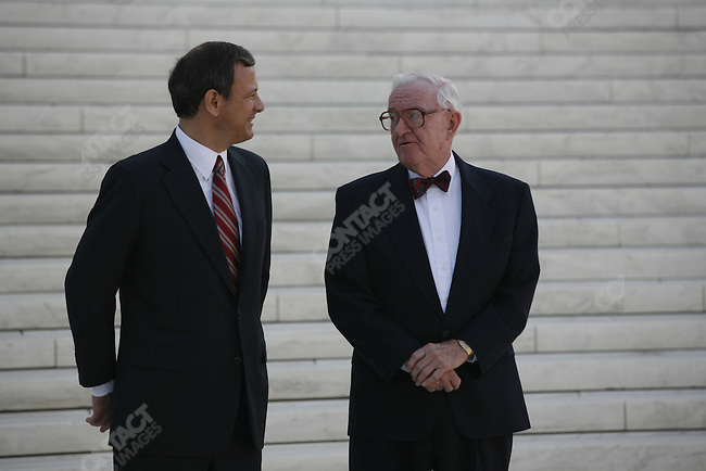 Just minutes after the official investiture of John Roberts as the new Chief Justice, Roberts and Associate Justice John Paul Stevens walk down the stairs of the Supreme Court Building. Washington, D.C., October 3, 2005.