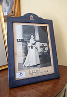 BNPS.co.uk (01202 558833)<br /> Pic: PhilYeomans/BNPS<br /> <br /> The house is full of Royal momento's, including these signed photograph's from the Queen.<br /> <br /> A remarkable 'time warp' Royal archive amassed by the Queen's dressmaker has been found inside his old country home.<br /> <br /> The late Ian Thomas was a dress designer for members of the Royal Family, including Her Majesty, for over 30 years.<br /> <br /> As an apprentice he worked alongside the renowned fashion designer Norman Hartnell on creating the Queen's coronation dress in 1953.<br /> <br /> His archive includes embroidered samples of the gown worn by Elizabeth II for the historic ceremony in Westminster Abbey that was broadcast to millions.<br /> <br /> Mr Thomas also designed outfits for the Queen Mother and Princess Margaret.