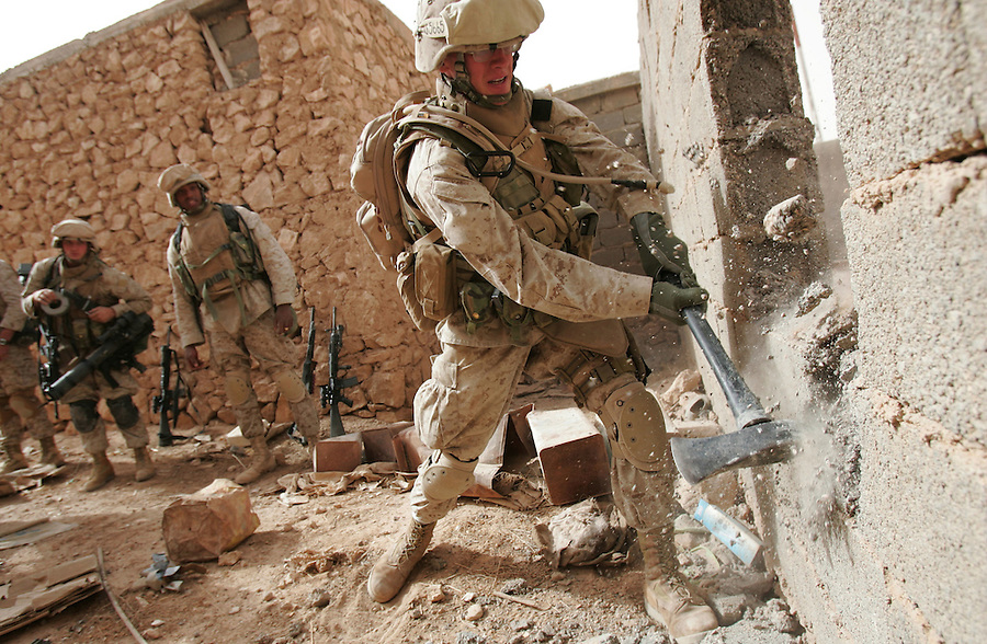 Members of Lima Co. 3rd Battalion 6th Marines take part in Operation Steel Curtain, an operation to clear Husaybah (a city on the Iraq-Syrian border) of insurgents on Sat. Nov. 5, 2005. The operation has been labeled by the US military as largest since Fallujah involving more 2,500 US personnel and 1,000 Iraqis.