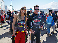 Mar 18, 2017; Gainesville , FL, USA; NHRA top fuel driver Leah Pritchett with sponsor Papa Johns Pizza founder John Schnatter during qualifying for the Gatornationals at Gainesville Raceway. Mandatory Credit: Mark J. Rebilas-USA TODAY Sports
