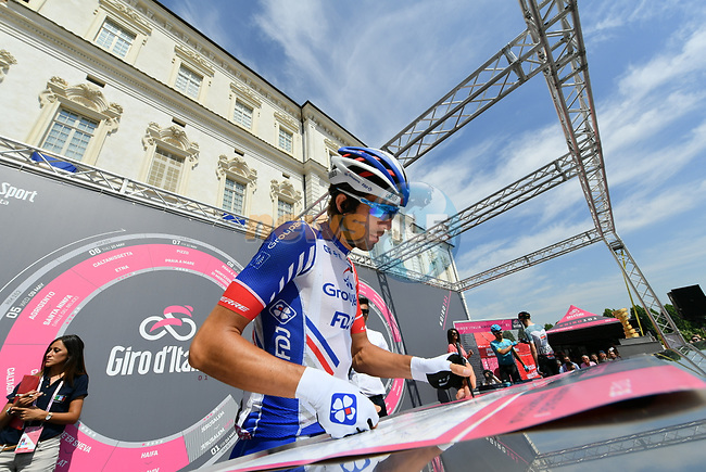 Thibaut Pinot (FRA) Groupama-FDJ at sign on before the start of Stage 19 of the 2018 Giro d'Italia, running 185km from Venaria Reale to Bardonecchia featuring the Cima Coppi of this Giro, the highest climb on the Colle delle Finestre with its gravel roads, before finishing on the final climb of the Jafferau, Italy. 25th May 2018.<br /> Picture: LaPresse/Gian Mattia D'Alberto | Cyclefile<br /> <br /> <br /> All photos usage must carry mandatory copyright credit (© Cyclefile | LaPresse/Gian Mattia D'Alberto)