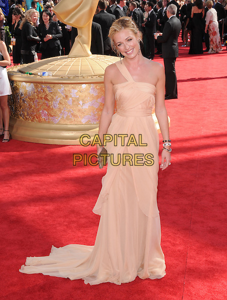 CAT DEELY.Arrivals at the 61st Primetime Emmy Awards held at Te Nokia Theater in Los Angeles, California, USA..September 20st, 2009     .emmys full length gold peach nude one shoulder strap beige clutch bag grecian dress bracelets long maxi .CAP/DVS.©Debbie VanStory/Capital Pictures.