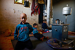LEBANON Deir el Ahmad, a maronite christian village in Beqaa valley, syrian refugee camp / LIBANON Deir el Ahmad, ein christlich maronitisches Dorf in der Bekaa Ebene, Camp fuer syrische Fluechtlinge, Huette von Soumaya Alkhatib, die Mutter des Jungen Ahmad, Ahmad im Bild hat heute 11. Geburtstag