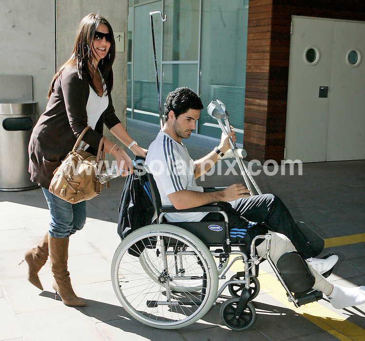 "**ALL ROUND PICTURES FROM SOLARPIX.COM**.**STRICTLY UK  SYNDICATION RIGHTS ONLY.**NO PUBLICATION IN SPAIN**.Everton FC Midfilder Mikel Arteta leaving ""Quiron"" Hospital in Barcelona with his girlfriend ex Miss Spain 1999 Lorena Berna 28 yrs. Mikel underwent  a successful operation on his injured ankle and will be recovering for at least one month according to doctors at the hospital. Mikel girlfriend ex Miss Spain 1999 Lorena Berna 28 yrs who is 3 months pregnant with their first  child was at his side the whole time...This pic:Mikel Arteta & Lorena Berna..JOB REF: 8635         MER       DATE:07.03.09.**MUST CREDIT SOLARPIX.COM OR DOUBLE FEE WILL BE CHARGED**.**ONLINE USAGE FEE GBP 50.00 PER PICTURE - NOTIFICATION OF USAGE TO PHOTO @ SOLARPIX.COM**.**CALL SOLARPIX : +34 952 811 768 or LOW RATE FROM UK 0844 617 7637**"