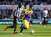 Pictured: Pablo Hernandez of Swansea (R) against Cheik Tiote (L) of Newcastle. Saturday 19 April 2014<br />