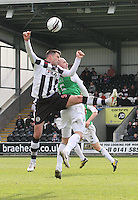 Steven Thompson (nearest) and James McPake in the air in the St Mirren v Hibernian Clydesdale Bank Scottish Premier League match played at St Mirren Park, Paisley on 29.4.12.