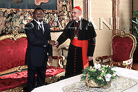 Cardinal Tarcisio bertone,Pope Benedict XVI shakes hands with Togo President  Faure Gnassingbe during an audience at the Vatican January 19, 2008..