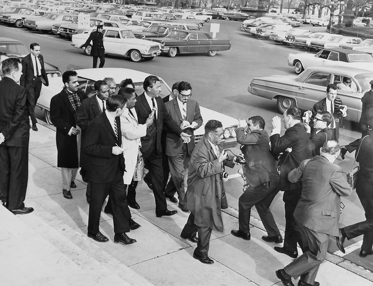Press photographers taking pictures of Rep. Adam Clayton Powell, D-N.Y. (Photo by Dev O'Neill/CQ Roll Call)