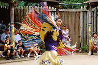 Tribal dance performance and competition. Traditional dance square. American Indian. Native tribe. Pow wow. Woman dancer. Livingston Texas, Alabama-Coushatta Indian Reservation.