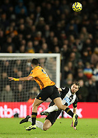 Newcastle United's Florian Lejeune is fouled by Wolverhampton Wanderers' Raul Jimenez<br /> Photographer Lee Parker/CameraSport<br /> <br /> The Premier League - Wolverhampton Wanderers v Newcastle United - Saturday 11th January 2020 - Molineux - Wolverhampton<br /> <br /> World Copyright © 2020 CameraSport. All rights reserved. 43 Linden Ave. Countesthorpe. Leicester. England. LE8 5PG - Tel: +44 (0) 116 277 4147 - admin@camerasport.com - www.camerasport.com