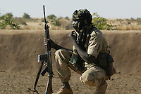 an officer  of the SLA (Sudan Liberation Army) takes a rest at a well in Amgou in north Darfur on Nov 2004.