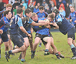 Gripping Cup Contest.....Castlebar's Shane Casey and Stephen Rogan combine to tie up Westport's Pat Hoban during the junior cup quarter final at Carrowholly on sunday last..Pic Conor McKeown