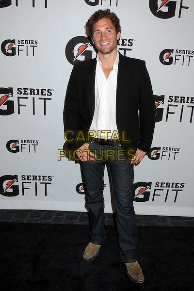JOHN BONAVIA.Gatorade G Series Fit Launch Event held at the SLS Hotel, Los Angeles, California, USA..April 12th, 2011.full length jeans denim jacket shirt black white  .CAP/ADM/BP.©Byron Purvis/AdMedia/Capital Pictures.