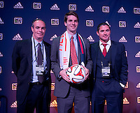 #11 overall pick Patrick Mullins of the New England Revolution stands with head coach Jay Heaps (right) during the MLS SuperDraft at the Pennsylvania Convention Center in Philadelphia, PA, on January 16, 2014.