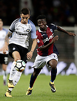 Calcio, Serie A: Bologna, stadio Renato Dall'Ara, 19 settembre 2017.<br /> Inter Milan's Matias Vecino (l) in action with Bologna's Godfred Donsah during the Italian Serie A football match between Bologna and Inter Milan at Bologna's Renato Dall'Ara stadium, September 19, 2017.<br /> UPDATE IMAGES PRESS/Isabella Bonotto