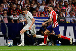 Saul Niguez of Atletico de Madrid and Fede Valverde  of Real Madrid during La Liga match between Atletico de Madrid and Real Madrid at Wanda Metropolitano Stadium{ in Madrid, Spain. {iptcmonthname} 28, 2019. (ALTERPHOTOS/A. Perez Meca)
