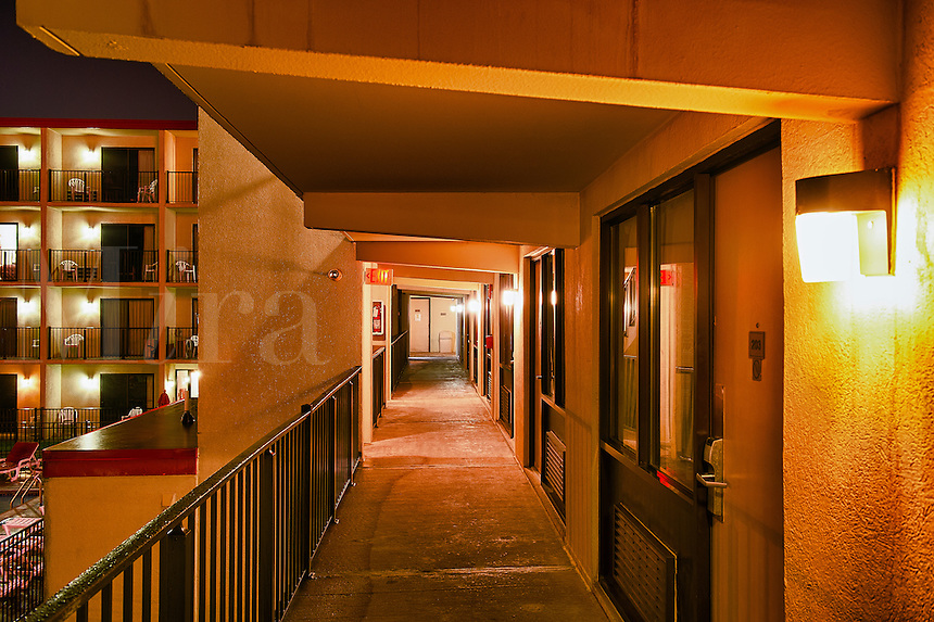 Hotel exterior at night.
