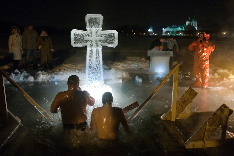 Moscow, Russia, 18/01/2011..An emergency worker watches as Orthodox Christian believers celebrate Epiphany at a lake in eastern Moscow. Priests blessed the waters and followers baptised themselves by total immersion in the freezing lake in temperatures of minus 15C.