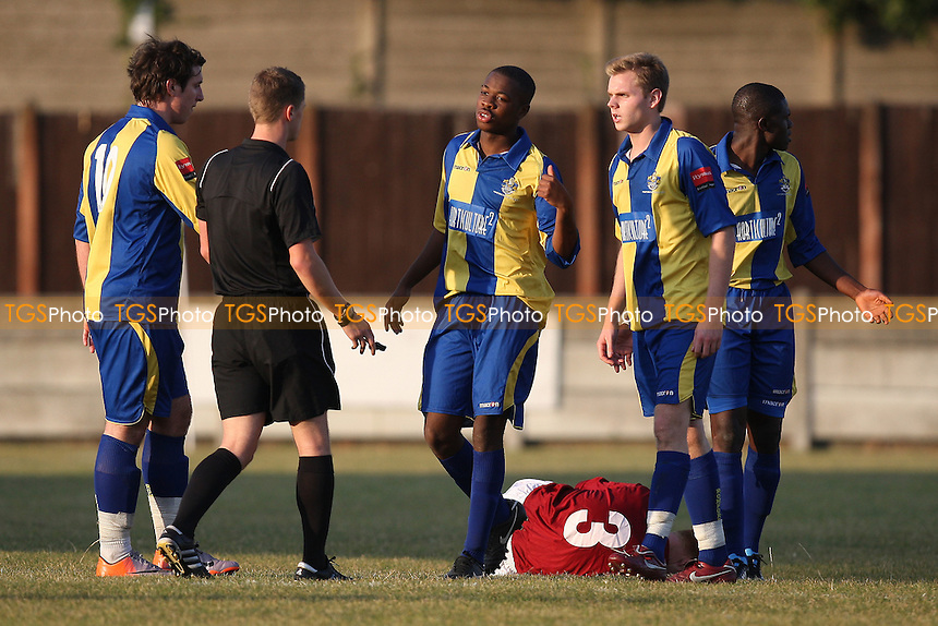 Jack Barry of Romford challenges Shane Wardley of Leiston and is subsequently booked - Romford vs Leiston - Ryman League Division One North Football at Mill Field, Aveley FC - 21/10/11 - MANDATORY CREDIT: Gavin Ellis/TGSPHOTO - Self billing applies where appropriate - 0845 094 6026 - contact@tgsphoto.co.uk - NO UNPAID USE.
