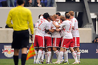 Thierry Henry (14) of the New York Red Bulls  celebrates scoring with teammates  during the first half against the Colorado Rapids during a Major League Soccer (MLS) match at Red Bull Arena in Harrison, NJ, on March 25, 2012.