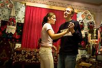 ROMANIA / Maramures / Breb / 04.09.2006 ..Bogdan Hordoban, 17, dances with Ancuta Taut, also 17, in her room. ..© Davin Ellicson / Anzenberger
