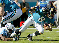 Tennessee Titans defender Carlos Hall (#97) sacks Jacksonville Jaguars quarterback Mark Brunell during a game against the Jacksonville Jaguars in Jacksonville, FL on Sunday, December 22, 2002.  Tennessee won the game 28 to 10.  (Photo by Brian Cleary/www.bcpix.com)
