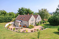 BNPS.co.uk (01202 558833)<br /> Pic: StagsProperty/BNPS<br /> <br /> Chateauneuf du Pape! ! - Beautiful Somerset property comes with its own 6 acre vinyard.<br /> <br /> A stylish country home has been dubbed the perfect house for any wine lover - as it comes with its own vineyard and bottling plant within its grounds.<br /> <br /> Wraxall Vineyard in Somerset is up for sale for £1.25m and includes a tasting room, shop and and its own wine cellar.<br /> <br /> The spot is used by the current owners to run tasting tours around the grounds and space is available to expand the vineyard by another five acres should demand outstrip supply.<br /> <br /> The picturesque vinyard produces over 17 tons of grapes in a good year - enough for 5300 bottles of lovely sparkling wine.