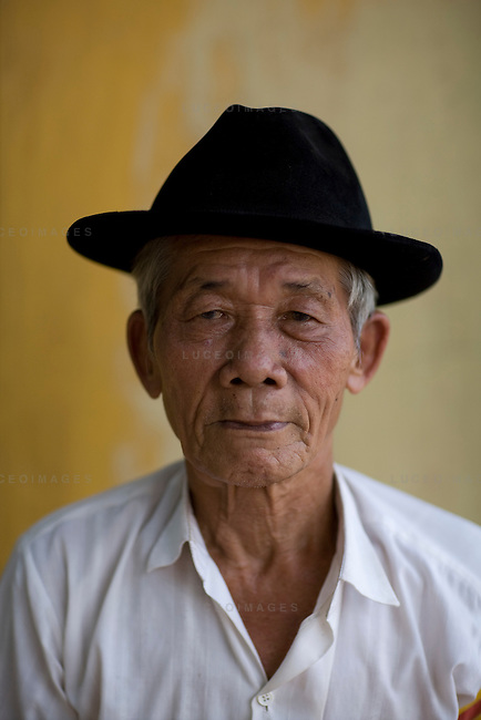 A follower of the Cao Dai religion wait for the daily ceremony to begin in Tay Ninh, Vietnam.