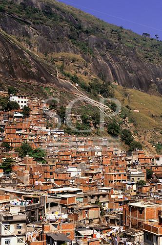 Rio de Janeiro, Brazil. Rocinha favela shanty town with the rocks rising behind.