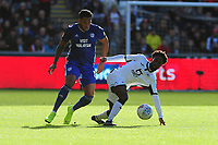Nathaniel Mendez-Laing of Cardiff City vies for possession with Nathan Dyer of Swansea City during the Sky Bet Championship match between Swansea City and Cardiff City at the Liberty Stadium in Swansea, Wales, UK. Sunday 27 October 2019