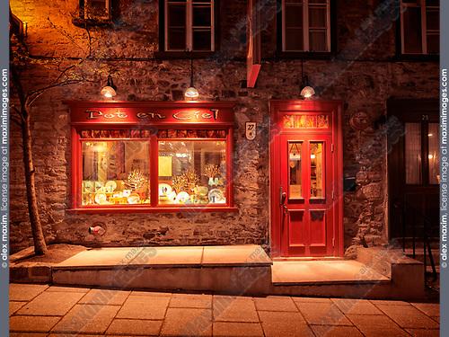 Illuminated at night shop display window of Pot-en-Ciel store on Petit Champlain street in Quebec old town, Canada. Rue du Petit-Champlain, Ville de Québec.