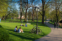 Girls sitting on the lawns in Bastion Hill park, Riga, Latvia