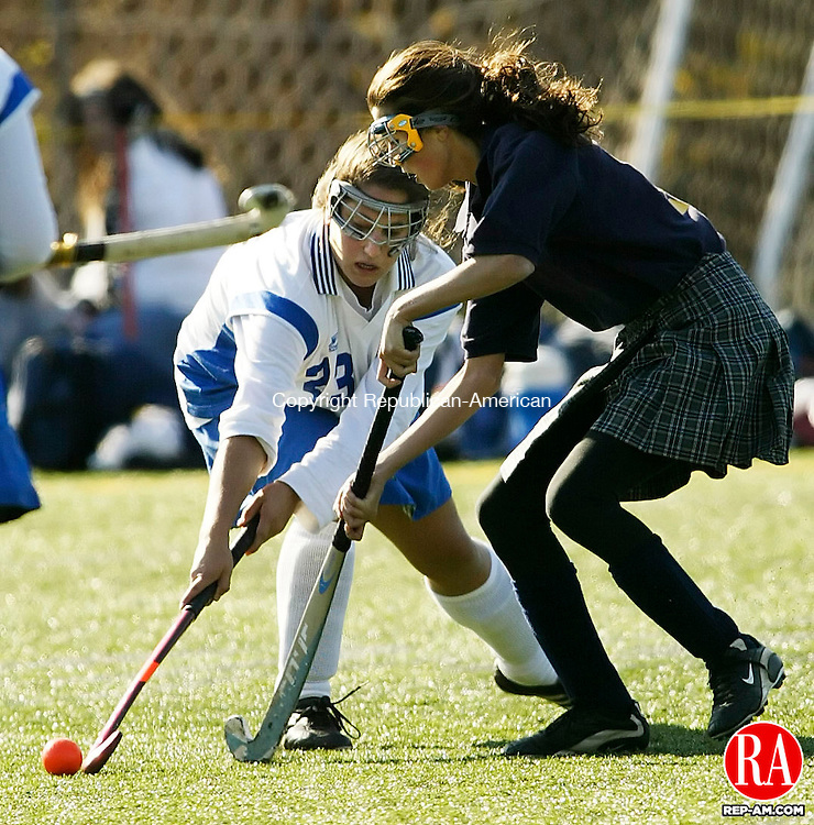 WETHERSFIELD, CT 19 November 2005 -111905BZ11-  Lewis Mills #23, Justine Perna, left, and  Haddam-Killingworth #13, Meghan O'Leary <br /> <br /> battle for the ball during the Class S field hockey finals at Wethersfield High School Saturday. <br /> Jamison C. Bazinet Republican-American