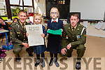 Irish defence forces Lt Denis Sheahan and  Gunner Noel Lynch presented the Tri Colour and Proclamation to Hazel Conway and Megan Lawlor of Ballincrossig National School in Ballyduff on Thursday