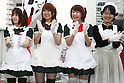 Apr 20, 2010 - Tokyo, Japan - Maid working as staff at cafes and member of the NPO Licolita pose for a group photo during the 'Akihabara Kitchen Garden Kick-off' event on a rooftop in Akihabara district area, Tokyo, Japan, on April 20, 2010. For the second consecutive year, the project aims to bring down the temperature in the district area.