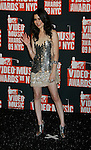 NEW YORK, New York - September 13: Miranda Cosgrove poses in the press room at the 2009 MTV Video Music Awards at Radio City Music Hall on September 13, 2009 in New York City.