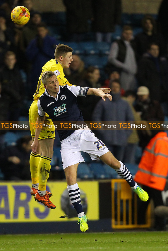 Steve Morison of Millwall rises with John Lundstram of Oxford United during Millwall vs Oxford United at The Den